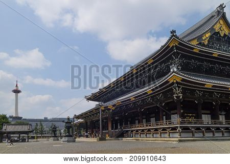 Kyoto, Japan -  May 23, 2017: Higashi Honganji's Goeido temple,the head temple of the Otani faction of Jodo-shin Buddhism in Kyoto with Kyoto tower at the background