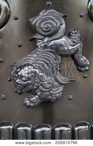 Kyoto, Japan -  May 23, 2017: Decoration of a guardian lion dog in the Higashi Honganji Temple in Kyoto