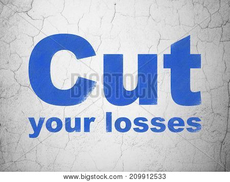 Business concept: Blue Cut Your losses on textured concrete wall background
