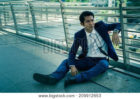 businessman unemployed from company sitting on the street concept of business failure and unemployment problem
