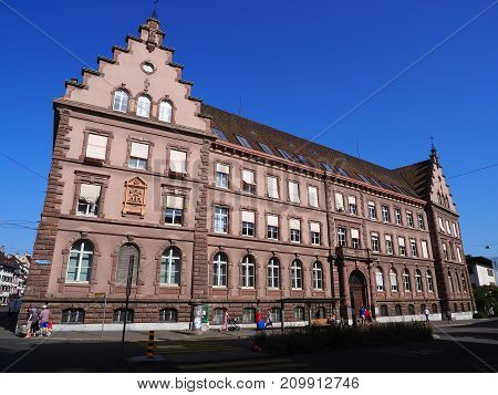 BASEL SWITZERLAND EUROPE on JULY 2017: Representative historical building and people on square in swiss city center with clear blue sky in warm sunny summer day.