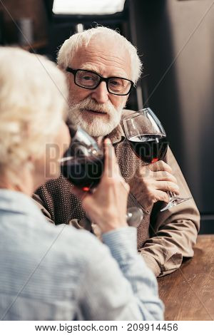 european senior couple drinking red wine together