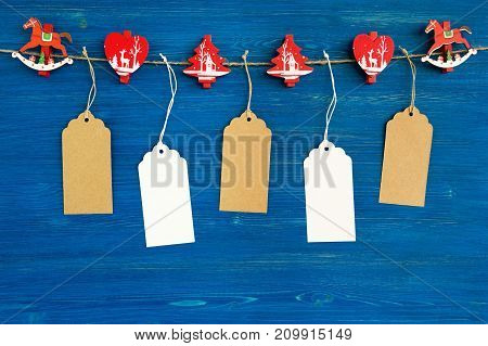 Brown And White Blank Paper Price Tags Or Labels Set And Christmas Wooden Decorations Hanging On A R