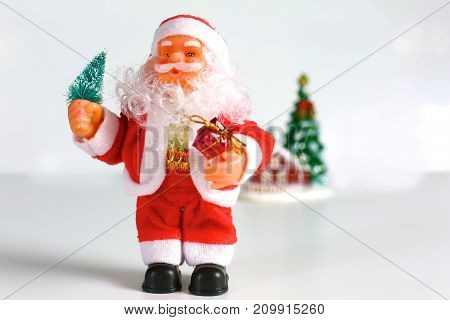santa claus standing in front of white background.