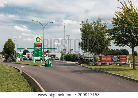 NORMANDIE, FRANCE - AUGUST 23, 2017: Gas station of the oil company British Petroleum BP on a French toll road in Normandie. A big billboard is situated beside the way in.
