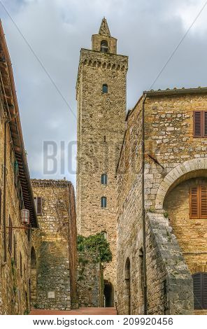 street with Torre (tower) Grossa in San Gimignano Italy