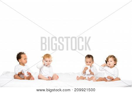 Multicultural Toddlers Holding Smartphones