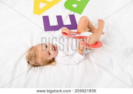 Happy Baby With Paper Letter