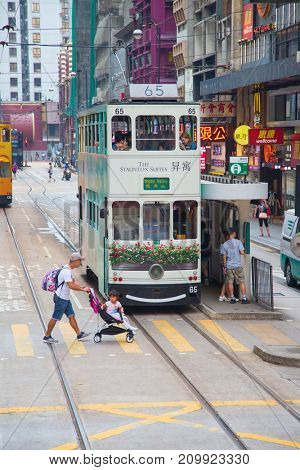 HONG KONG - OCTOBER 02: Unidentified people using tram in Hong Kong on October 02, 2017. Hong Kong tram is the only in the world run with double deckers and one of the main tourist attractions.