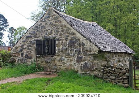 Historic stone farmhouse building in rural Wales