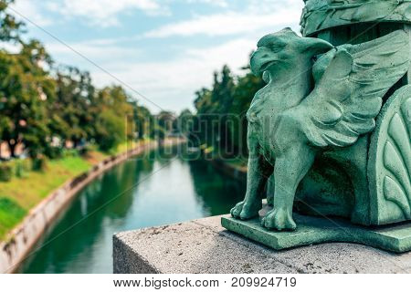 Slovenia, Ljubljana - The Dragon Bridge statues. The Dragon Bridge was built in the beginning of the 20th century, when Ljubljana was part of the Austro-Hungarian Monarchy.