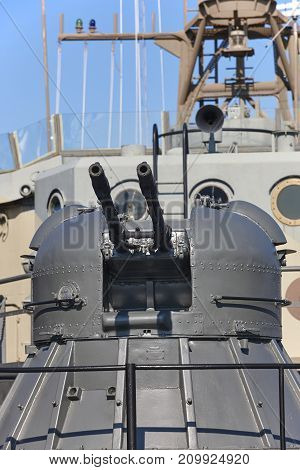 Machine gun on a vessel war destroyer. Naval weapon. Army