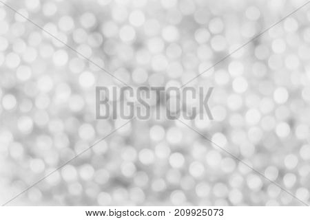 White and silver bokeh abstract light background.