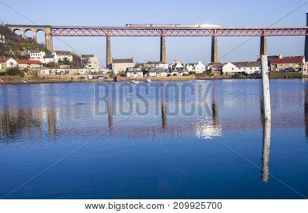 Train passing Abutments on Forth Rail Bridge. Forth rail bridge connecting Edinburgh to Fife Scotland