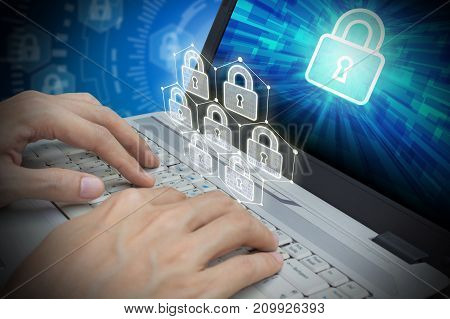 Businessman use Laptop with padlock on screen and padlock virtual technology Cyber Security Data Protection Business Technology Privacy concept Internet Concept of global business.
