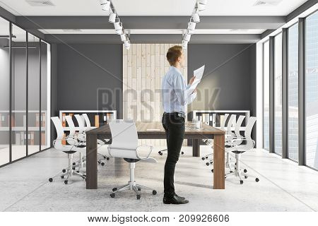 Handsome european businessman standing in modern conference room with equipment and sunlight. Employee worker excecutive concept. 3D Rendeirng