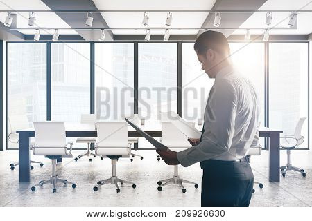 Handsome european businessman standing in modern boardroom with equipment and sunlight. Employee worker excecutive concept. 3D Rendeirng