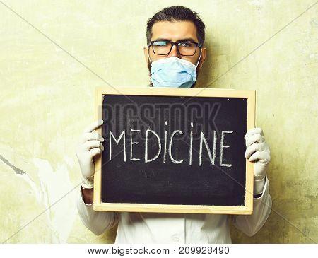 Bearded Brutal Caucasian Doctor Or Postgraduate Student Holding Board