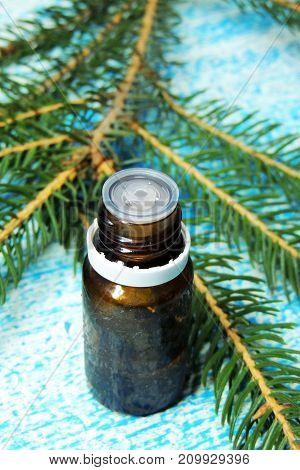 Essential oil blend. Dark glass bottles, cinnamon, pine twigs, dried citrus slice, anise, woolen wrap. Natural home deodorants. Warm toned.
