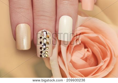 Multi-colored pastel manicure square shape with rhinestones.