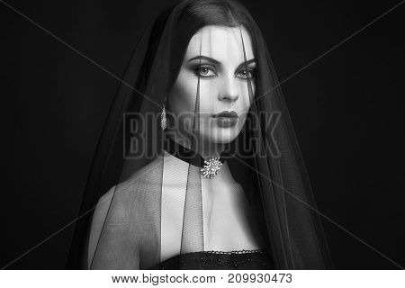 Halloween Woman portrait. Beautiful Glamour Fashion sexy lady with dark Veil Beauty make up and Costume