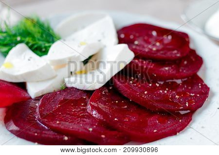 Beet root salad with feta cheese on white background