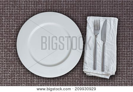 Empty plate and cutlery on multiplex plate.