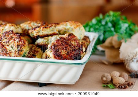 Home meatballs with spices on a wood background