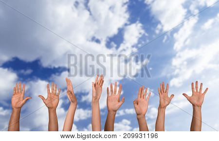Hands rising rising up group large background circle