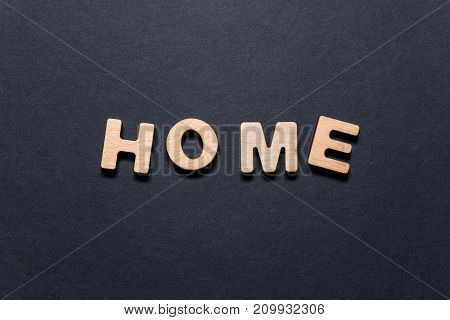 Word Home Of Wooden Letters On A Dark Texture With A Black Background