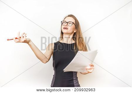 a young modern woman teacher emotionally tells something, holds a pen and sheets of paper