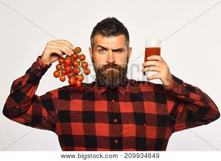 Farmer With Serious Face Holds Cherry Tomatoes And Fresh Juice.