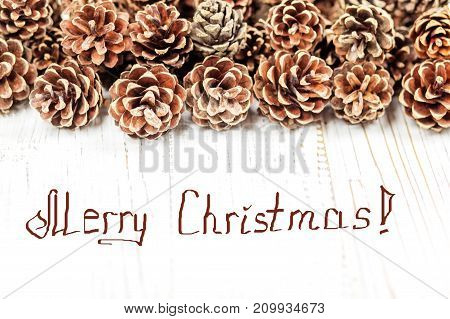 Cones on a wooden background. Concept Happy Christmas New Year holiday winter.
