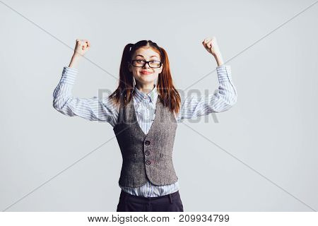 young happy girl in glasses and office clothes smiling