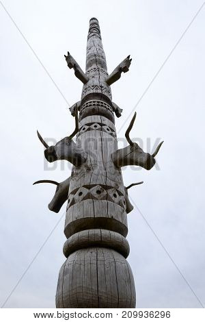 A wooden totem pole representing the idol surrounding the ancient settlement in the North of Russia