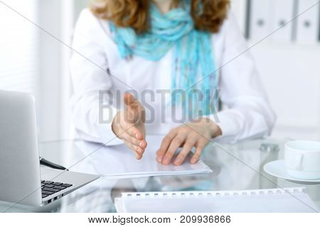Business woman with hand out for handshake. Close-up of an open hand. Partnership or agreement concept for success communication