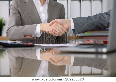 Group of business people or lawyers at meeting  shaking hands, close-up