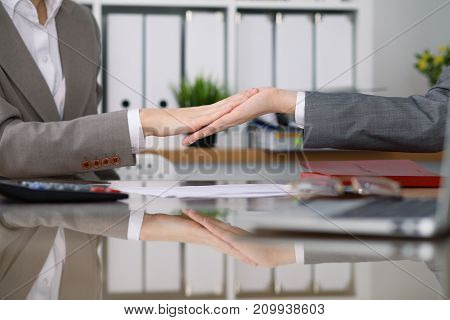 Two female accountants checking financial statement or counting by calculator income for tax form, hands close-up. Internal Revenue Service inspector checking financial document. Planning budget and audit concept.