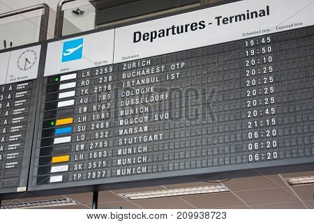 Flight Information Board at the International Airport departure terminal timetable.