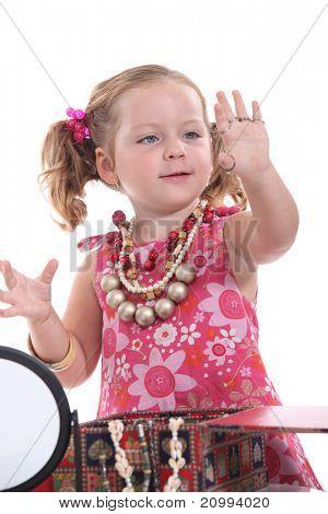 Girl putting on jewellery