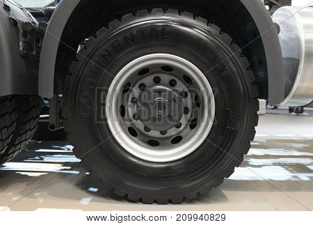 MOSCOW, SEP, 5, 2017: View on Volvo truck rear axle wheels and tires. Truck wheel rim. Truck chassis exhibit on Commercial Transport Exhibition ComTrans-2017. New clean wheel. Truck rear axle