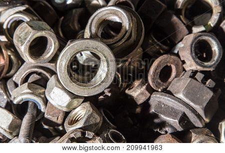 Detail of different metallic bolts and nuts