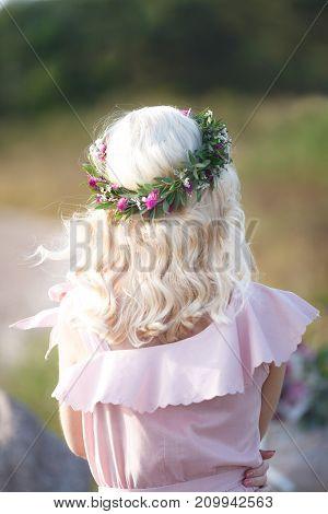 Flower wreath on a head (back view)