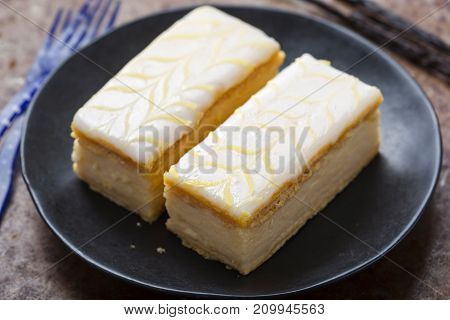 Vanilla slices. Puff pastry filled with vanilla custard topped with fondant icing.