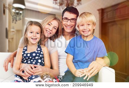 Smiling family home looking at camera fun white beautiful