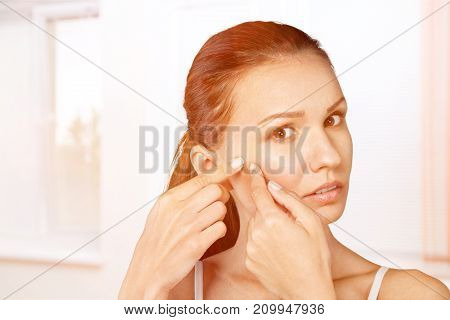 Face woman touching attractive white background beautiful