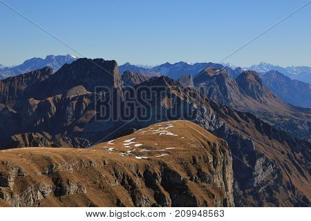 Autumn day in the Swiss Alps. View from mount Chaeserrugg.