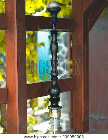Hookah on a summer terrace with a blurred background