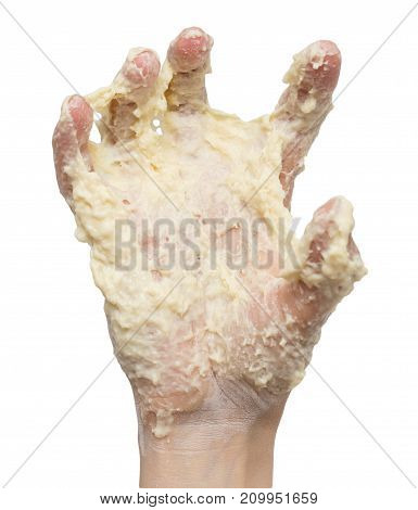 dough in hand on a white background