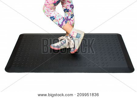 Close up of woman going to take sports on black mat